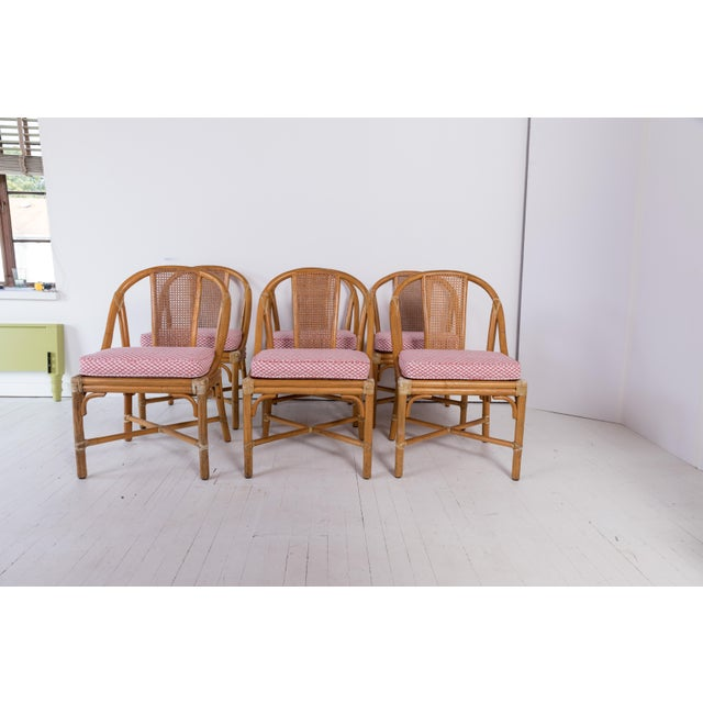 A set of 6 Madcap Cottage McGuire Furniture rattan dining chairs with leather wrapping. Cane seats and backs. New...