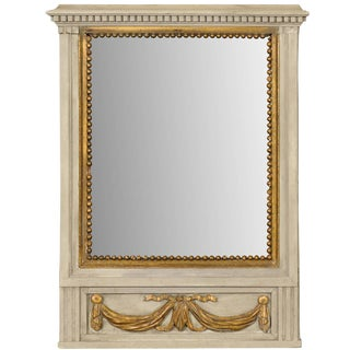 French Mirror in Small Size With Antiqued Glass and Gold Swag Motif on Beige For Sale