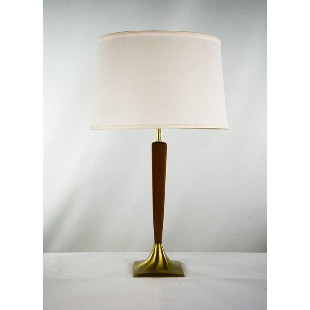 Keep your bedside table simple yet captivating with this 1960-1970's Mid-Century Danish Modern teak table lamp. The...