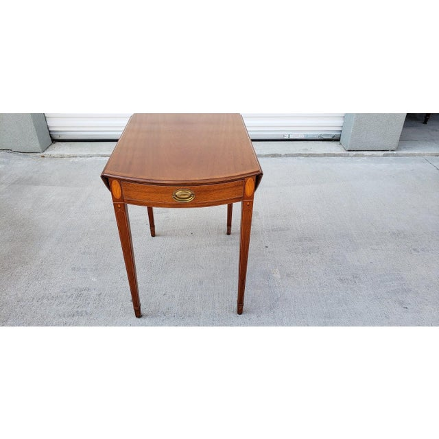 Antique Biggs mahogany pembroke drop leaf occasional table with sea shell inlay. Made in the 1950s. **Please note, I will...