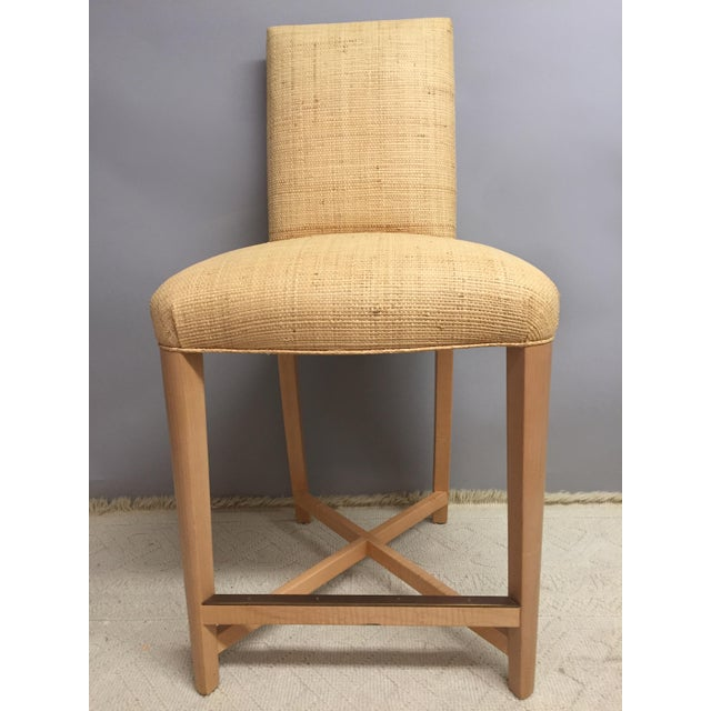 Exquisite Pair of Signed Donghia Designer Bar Stools upholstered in raffia, bleached wood legs with brass accents. Made in...