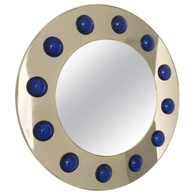 Round mirror in polished brass finish decorated with large dark blue Murano glass hemispheres / Designed by Fabio Bergomi...