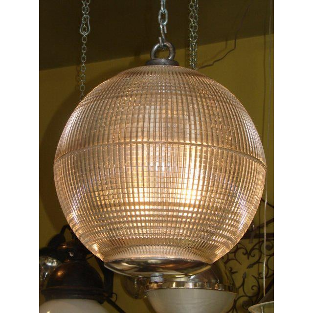 Impressive original French Holophane glass ball light, cast iron top and original bottom fittings; custom fittings and...