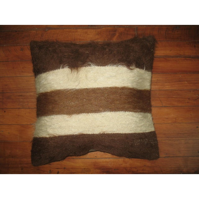 Pillow made from a Vintage Turkish Rug with cotton back. Zipper closure and foam insert provided. 16''x16''