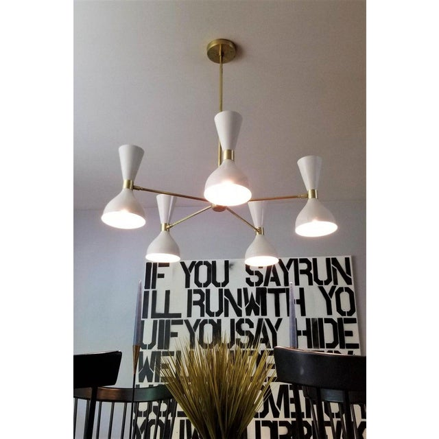 """Five-arm round """"Ludo"""" Chandelier shown in unlacquered brass and our """"Perfect White"""" enamel fabricated in NYC by Blueprint..."""