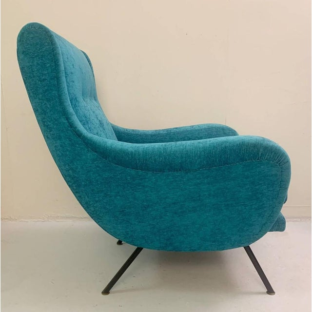 Pair of 1950's Mid-Century armchairs. 1950's Italian. Recently re- upholstered in rich turquoise fabric. Original Metal...