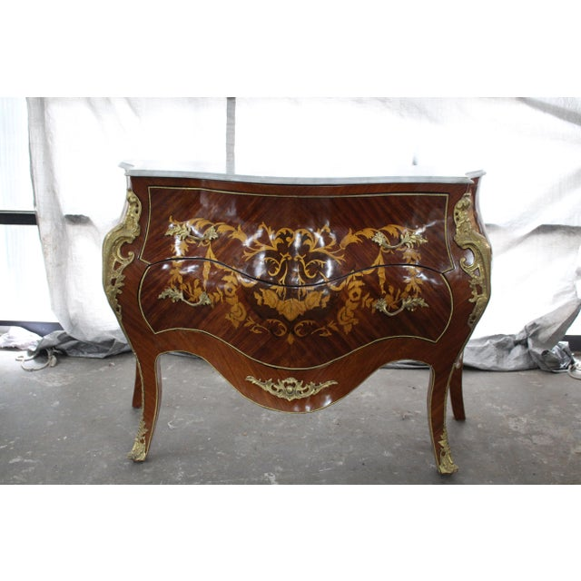 Bombay French commode/nightstand from the mid 19th century. The piece features double drawers, intricate inlay, bronze...