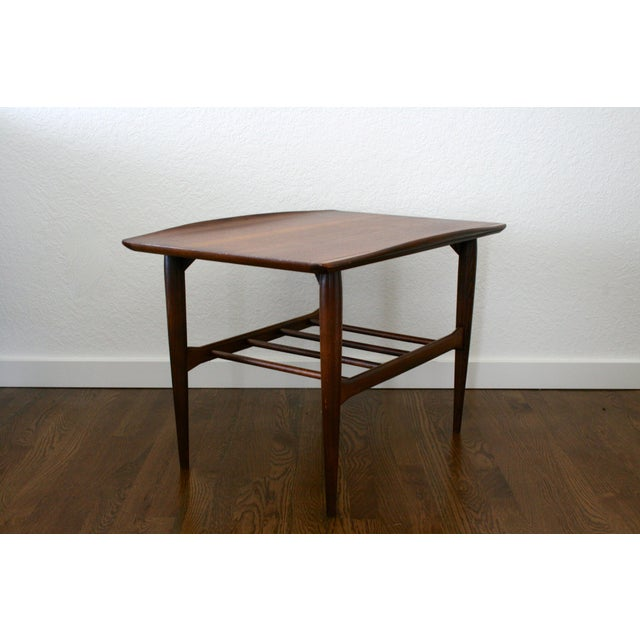 Pair of beautiful retro 1960s Danish style end side tables. Made by Bassett, these solid walnut side tables with gorgeous...