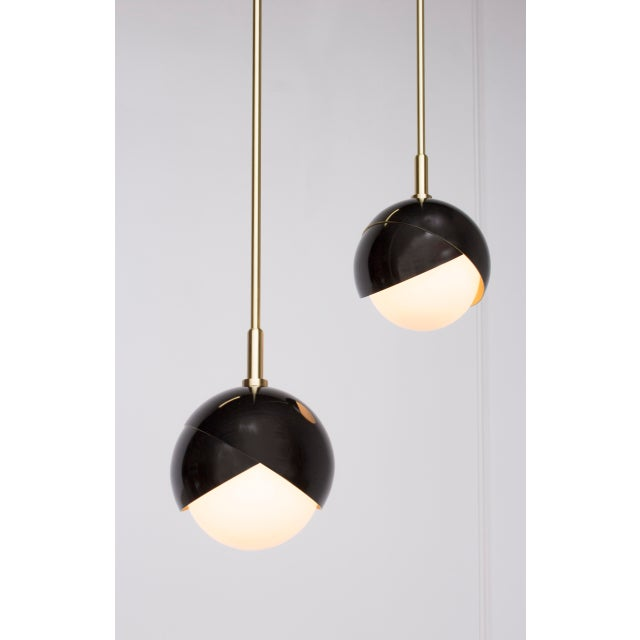 he Benedict pendant celebrates the defining detail of the Benedict Series. Two nested spun brass hemispheres cradle a hand...