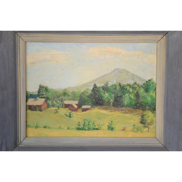 Charming framed rural landscape painting on board depicting a mountain farm scene with trees and barns. This...