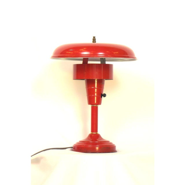 Mid-Century Modern table lamp featuring an original red painted finish.