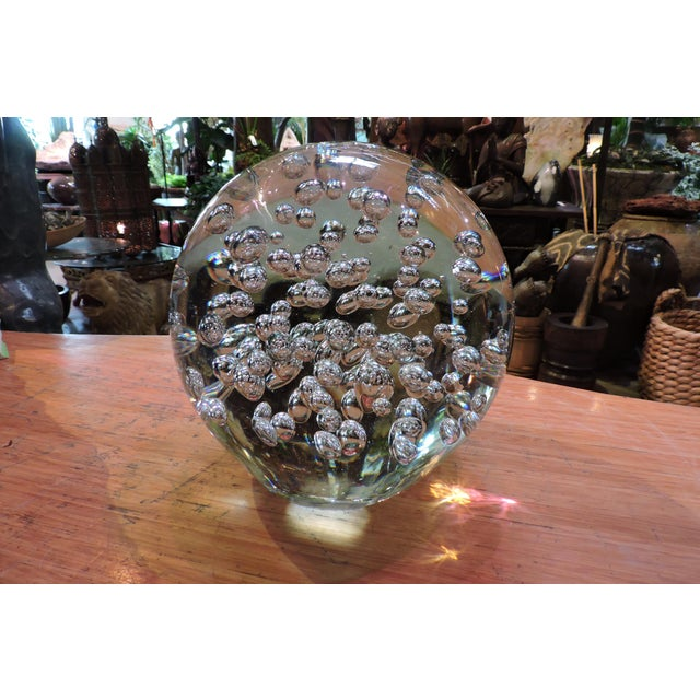 This bubble-filled clear glass globe is kind of fun. Light dances around the sphere and one wonders how do they make a...