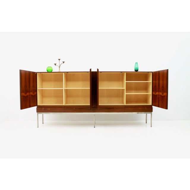 Very nice Highboard B60 by Dieter Waeckerlin for Behr in Rosewood. The frame is nickel-plated. The sideboard was designed...