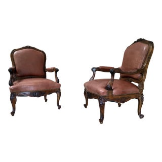 Pair Louis XV Style Hand Carved Walnut Distressed Leather Lounge Chairs