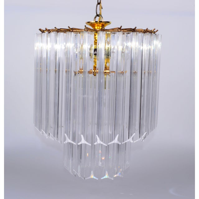 Five Light Lucite and Brass Chandelier with Canopy. Comes with 36 long Lucite prisms. Wired for the U.S. and uses five 25...