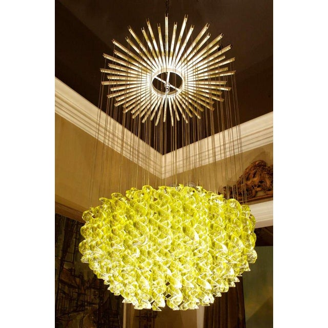 Venetian blown-glass pendant light fixture. Electrical piece marked milan. Each handblown spiral glass piece is suspended...