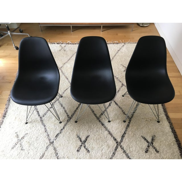 I am selling 3 original Eames Molded Plastic Chair/ Hermann Miller in black color with steel base. I never really used...