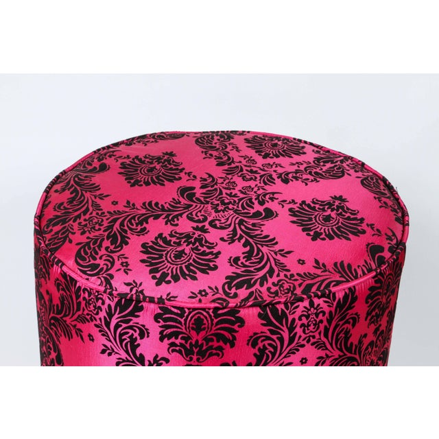 Pair of modern fuchsia and black Moroccan stools The upholstery is a damask fabric in floral taffeta with a raised velvet...