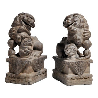 Pair of Stone Carved Fu Dogs on Pedestal For Sale