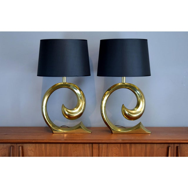 Brass is back, baby! This is a spectacular pair of early 1970s glam / Hollywood Regency style table lamps designed by...