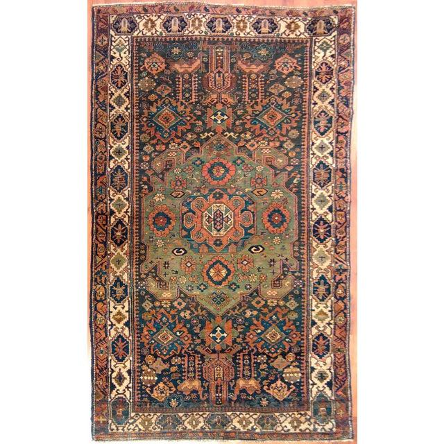 Rug # 534 Design: Caucasian Material: Wool Primary Color: Rust Secondary Color: Blue Description: Antique Rug
