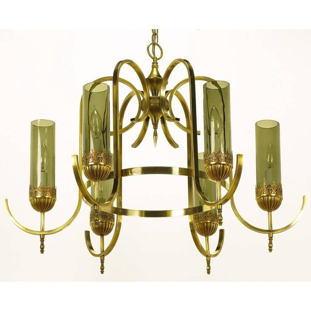 Gracefully swooping flat bar arms start at the center geometric pendant and finish at the brass ring. Each light is...