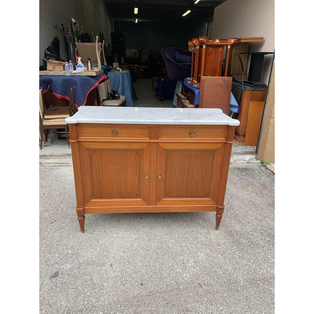 Fine French antique Louis XVI style sideboard or buffet made of mahogany with a beautiful Carrara marble top, the mahogany...