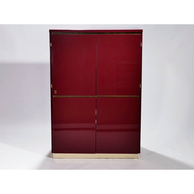 This luxurious cabinet is signed by French designer J.C. Mahey. Its boxy, simple style is typical of both the 1970s and...
