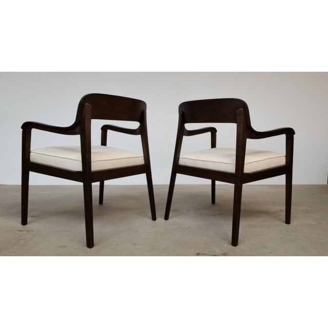 Pair of Riemerschmid chairs, circa 1955, designed by Edward Wormley and produced by Dunbar. Newly reupholstered and...
