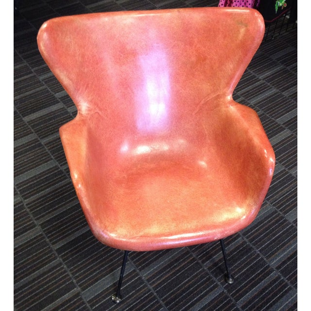 A salmon-colored shell chair equals instant Mid-century street cred. This Lawrence Peabody chair is in good condition...