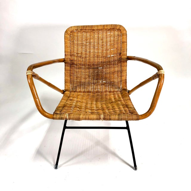 Stylish mid century meets boho chic vintage circa 1960s Italian chair with rattan body and metal legs and support.