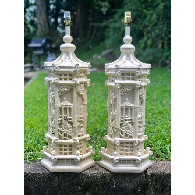 These matching pair of vintage pagoda lamps are KNOCKOUTS! Both have an off-white painted finish. One is a bit more...