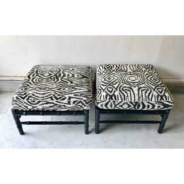 Plush velvet zebra print pillows are placed on a Chinoiserie black lacquered bamboo base for a perfect regency look.