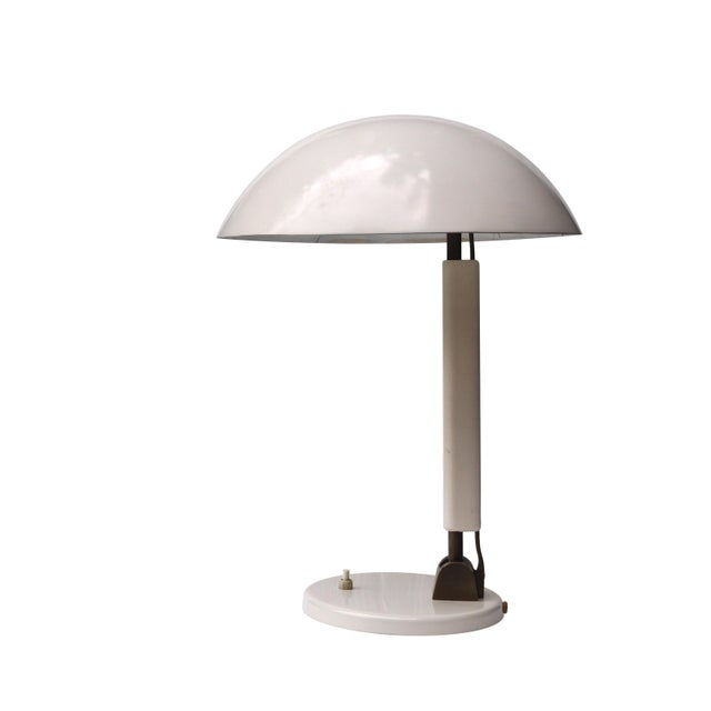 An Industrial desk lamp deeply steeped in the ethos of Swiss and German Modernism. The simplified and lighter look...