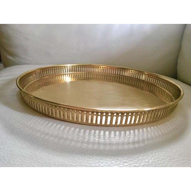 Vintage and stylish brass pierced round decorative or bar tray. No maker's marks.