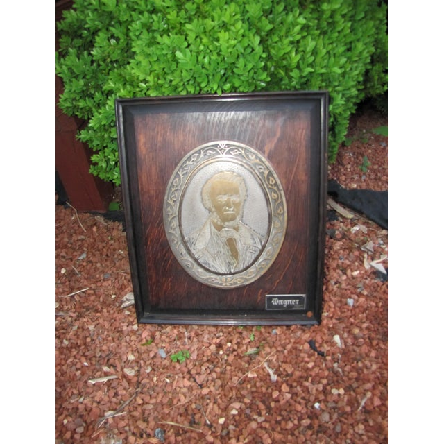 This is an Antique Wagner Plaque from the early 1900's. It is in good condition and it is very heavy. It has nice wood and...