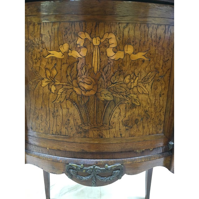 This lovely antique French side table with inlay, marble top and bronze ormolu is in very good condition. It is the...
