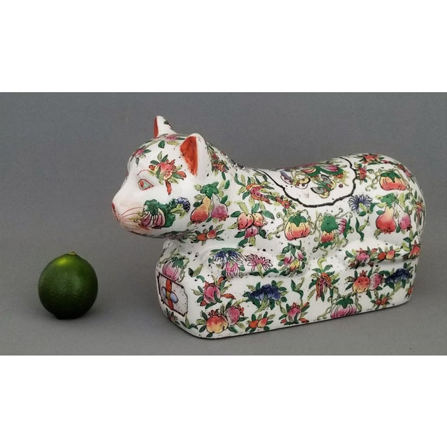 Offering a rare and unique antique porcelain cat sculpture, made in China. It was most likely made in the early 20th...