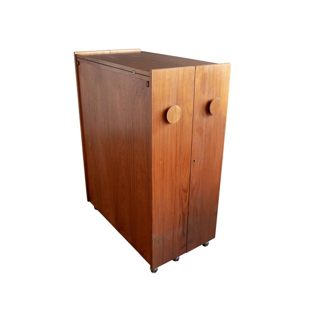 A folding bar cabinet or dry bar designed by Erik Buch for Dyrlund, ca. 1960s. Featuring a teak cabinet that opens to...
