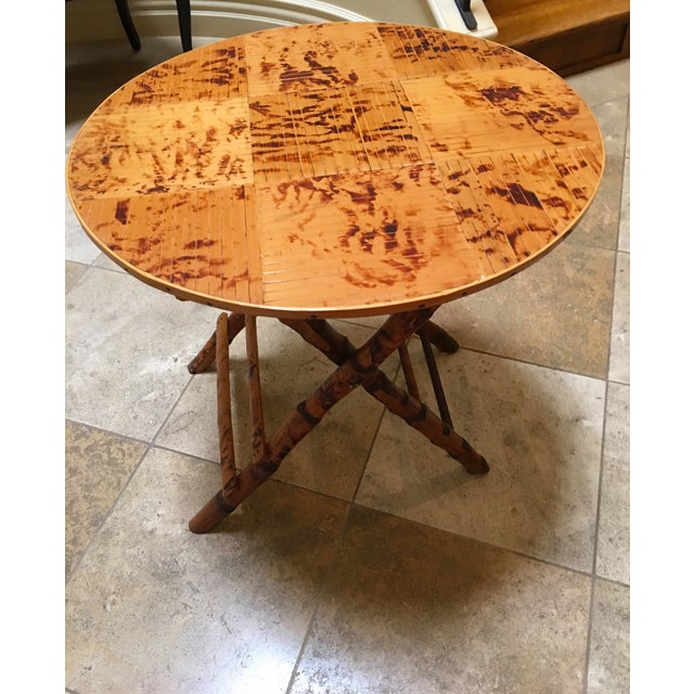 Vintage Bamboo round folding table. Purchased at an antiques store in Los Angeles. Has been used in many ways: side table,...