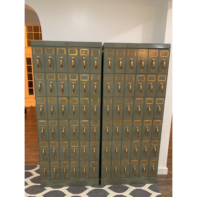A Large Vintage metal courthouse ledger file cabinet each with 36 drawers arranged veritcally in 6 rows of 6. With a...