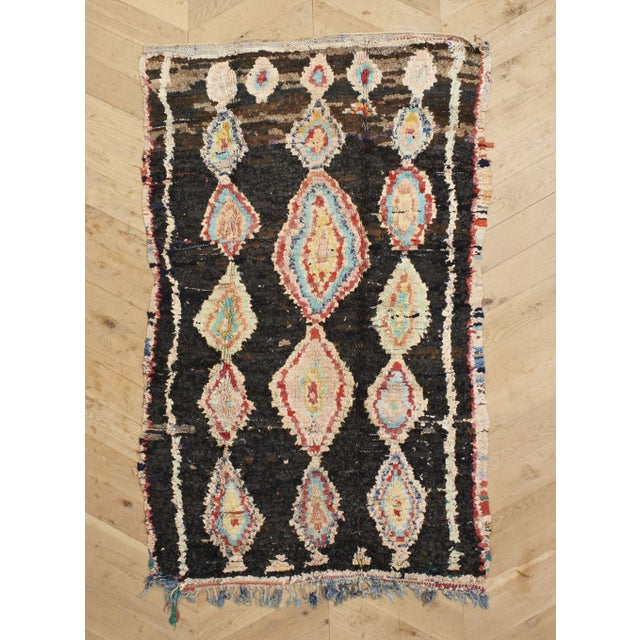 Our favorite thing about this vintage, one-of-a-kind rug is the streaks of color running through the darkness. This...