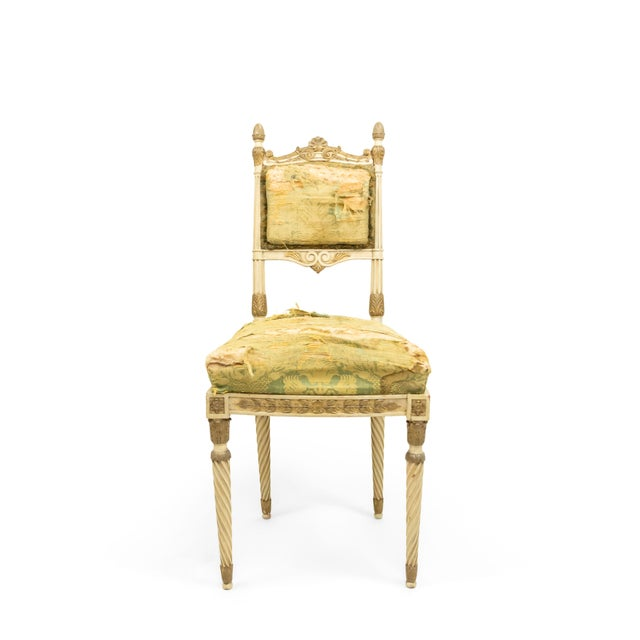 Set of 4 Italian Neoclassic style parcel gilt & cream painted side chairs with green damask silk upholstery above spiral...