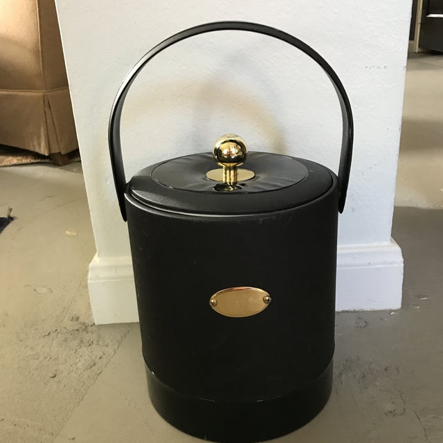 Georges Briard offers highly sought after and collectible barware. This ice bucket has an engravable plate on front for...