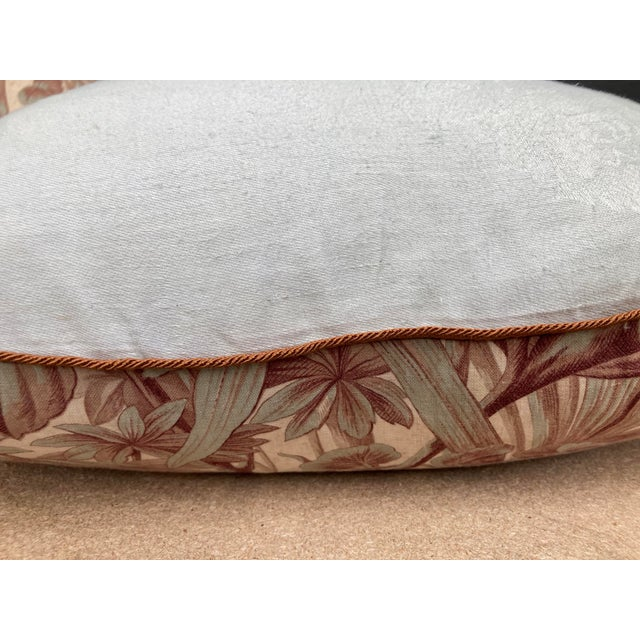 A pair of pillows made from a French 19th C. Printed cotton, backed with hand dyed linen damask, with a bow closure, down...
