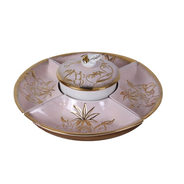 This 1950s Hoening pink lazy susan serving tray is wonderfully kitschy! A fruit motif is outlined in gold against the...