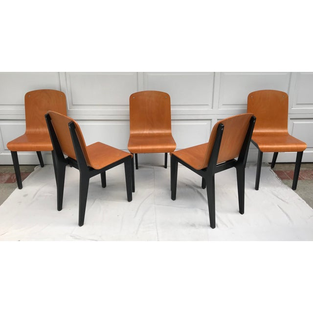 This is a set of 5 bent plywood chairs with so much character! I love how the base is stained in black, and cradles the...