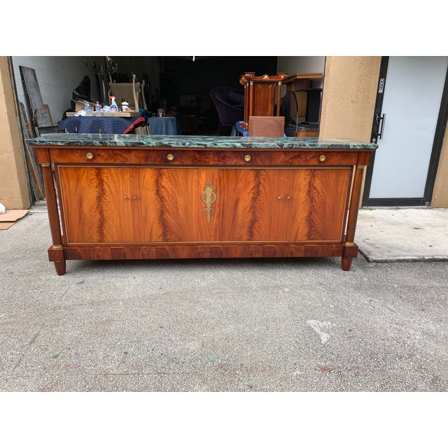Monumental French antique Empire sideboard or buffet made of mahogany with a beautiful green marble top, the mahogany wood...