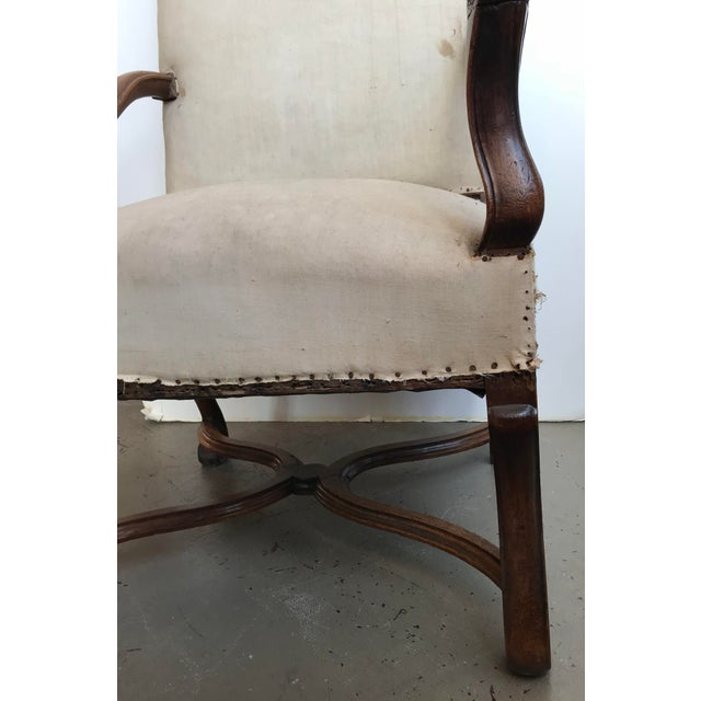 18th Century French Walnut Louis XIII Armchair with nailheads and cream upholstery.