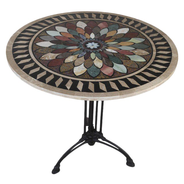 A black cast iron, Art Deco table (dining, breakfast, cafe, side table) base with a newer pietra dura specimen tabletop....
